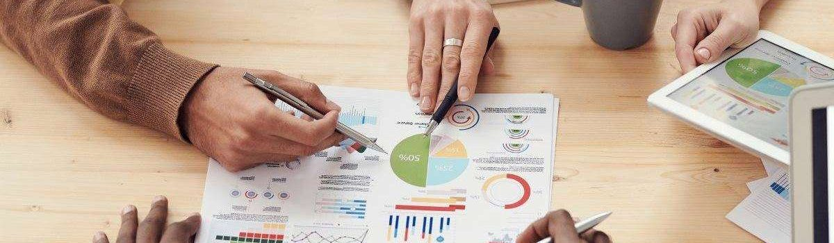 Marketing Definitions - Marketing Meeting Around A Table